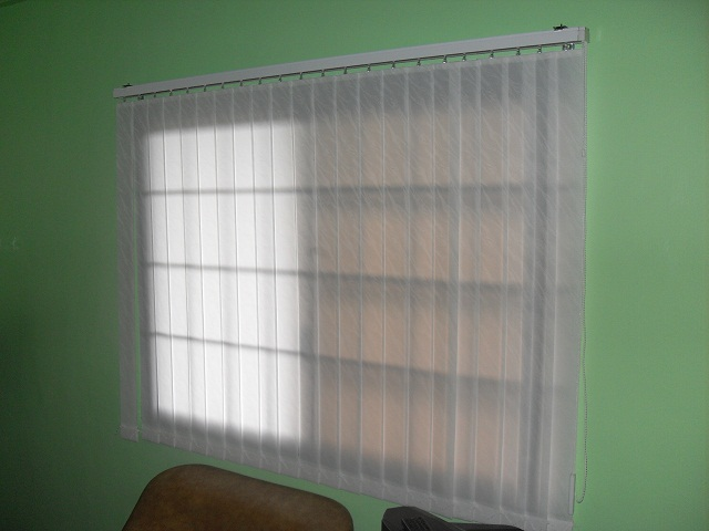 Fabric vertical blinds generating filtered lights