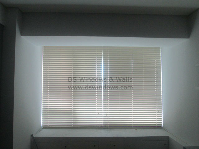 Faux Wood Blinds Installed In The Bedroom