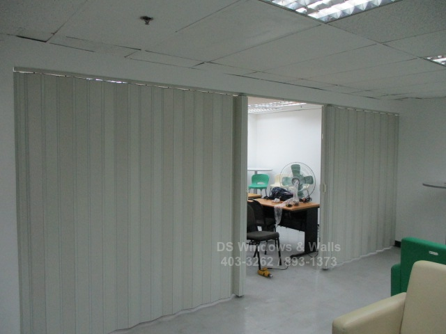 Dividing large office into two using folding doors